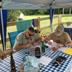 Tom Cannon and Pat Crowe hard at work judging July's competition